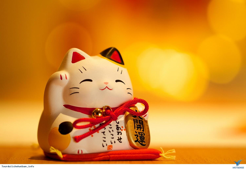 Maneki Neko, Mèo vẫy khách
